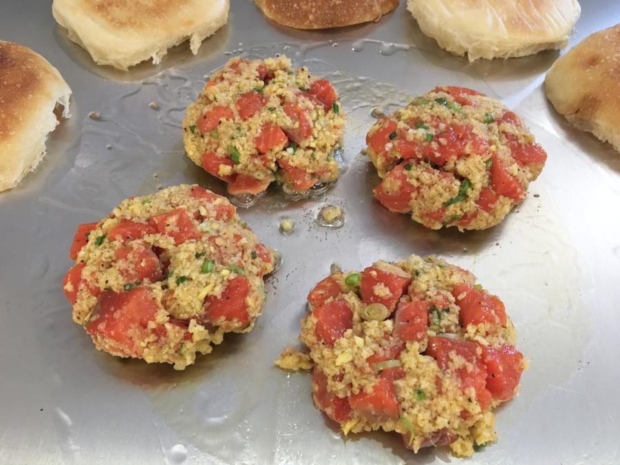 Salmon burger patties cooking on the Teppanyaki
